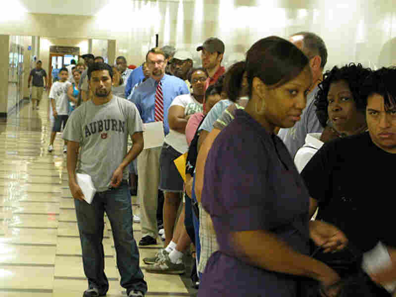 Jefferson County residents waiting in a long line for service at the county courthouse.
