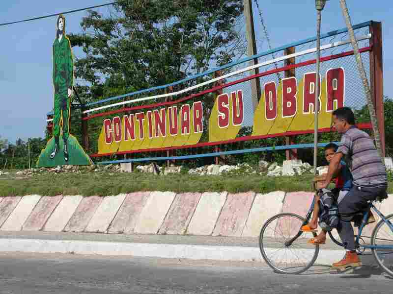 "In the city of Santa Clara, a Che Guevara billboard calls on Cubans to ""continue your work."""