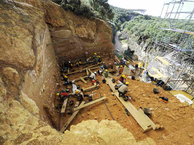 Workers excavate a section of the Sierra de Atapuerca mountains in northern Spain.
