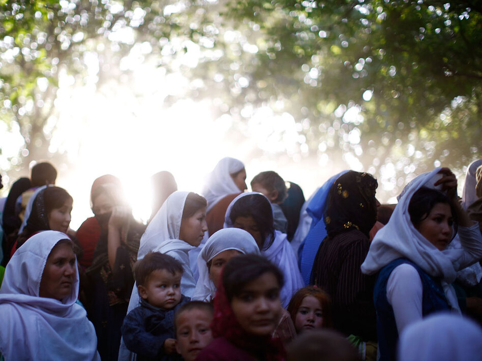 Several thousand men, women and children from four northern provinces of Afghanistan gather to meet their spiritual leader in the remote Dar-e-Kayan valley on July 3 — a day before President Hamid Karzai arrived.