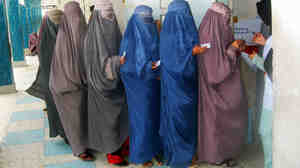 Wide: Women in Kandahar, Afghanistan, queue to learn how to vote in the upcoming presidential polls.