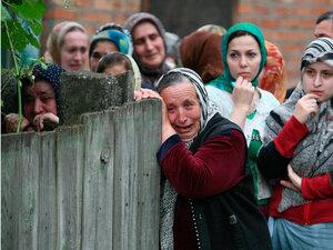 Women grieve during the burial of slain human rights activist Zarema Sadulayeva.
