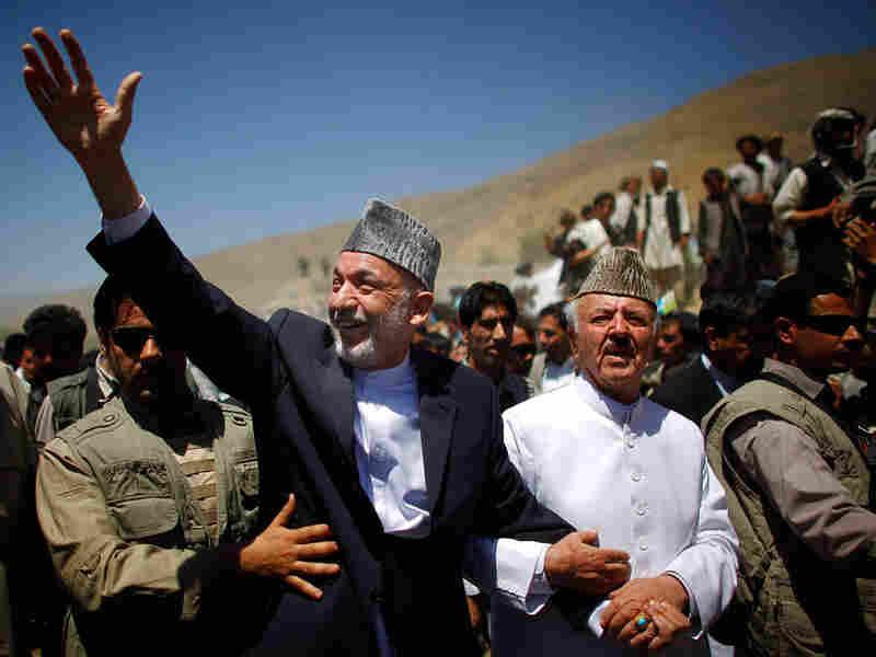 Afghan President Hamid Karzai and Mansoor Naderi