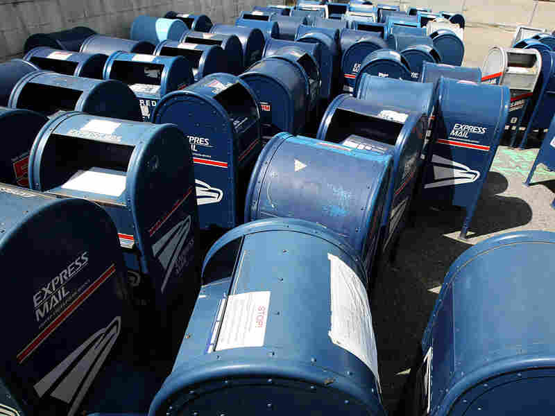 Dozens of retired mailboxes sit in San Francisco