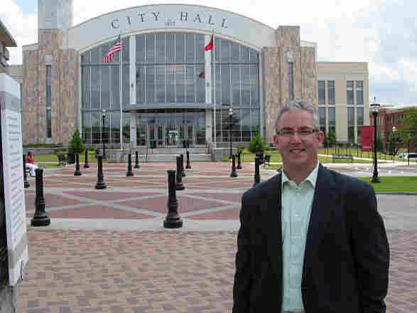 Suwanee, Ga., Mayor Dave Williams stands in front of City Hall