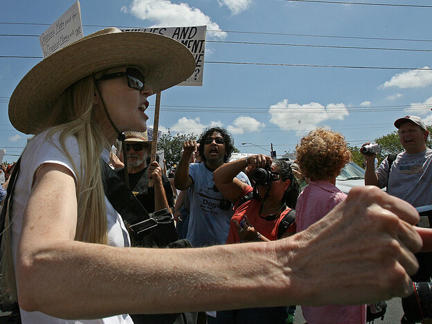 A woman shouts her opposition to the health care overhaul at a health fair held in Austin, Texas.