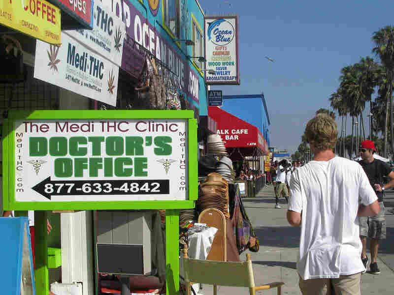 Signs like this are beginning to crowd the Venice Beach Boardwalk, but you may not want to get your