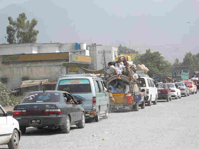 Residents of Mingora drive back to their town, which is the largest in Pakistan's Swat Valley.