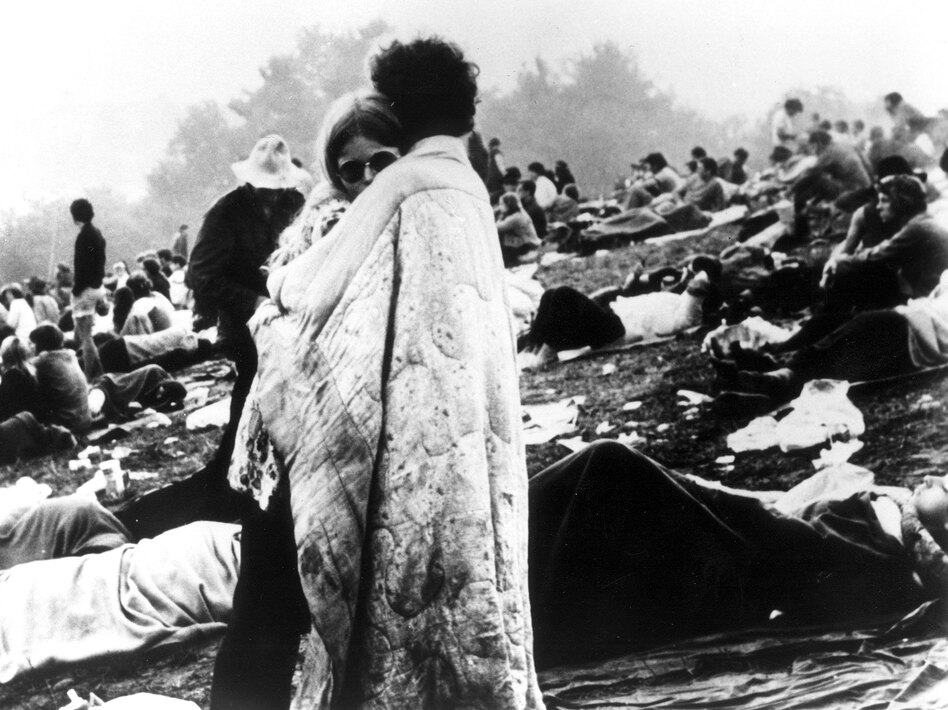 A couple hugs during the Woodstock Music and Art Festival in Bethel, N.Y, August 1969.