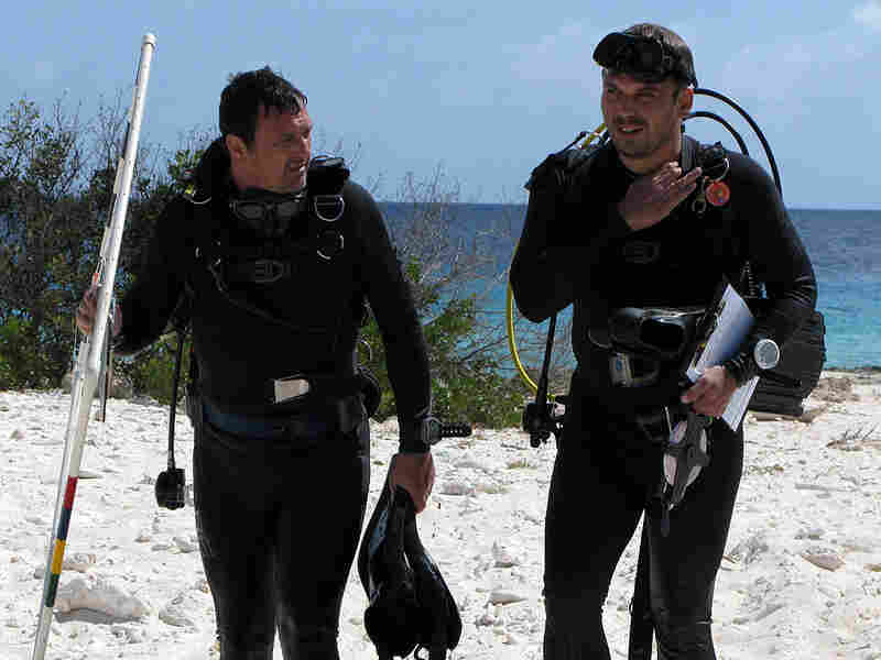 Ramon deLeon, left, and Mark Vermeij return from a dive to study the health of Bonaire's coral reef.
