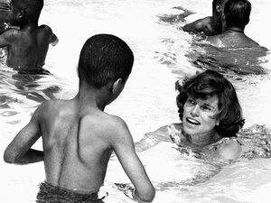 Eunice Kennedy Shriver is swims with youngsters at a camp for mentally challenged kids in 1964.