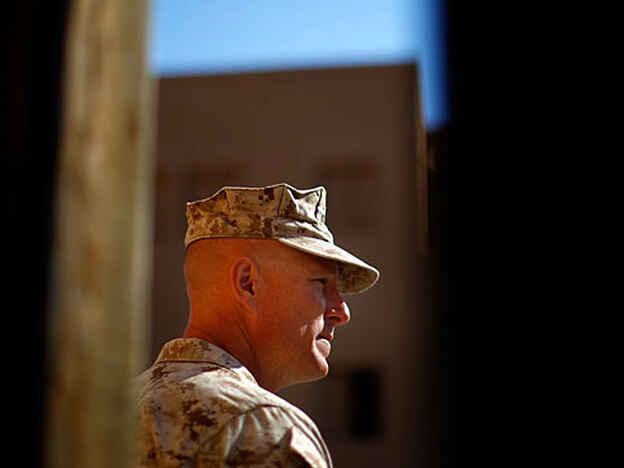 "Lt. Col. Christian Cabaniss talks with his troops in May during a training patrol at Camp Lejeune, N.C., before their deployment to Afghanistan. Nicknamed ""America's Battalion,"" the 2nd Battalion of the 8th Marine Regiment is operating in southern Afghanistan's Helmand province to counter Taliban insurgents."