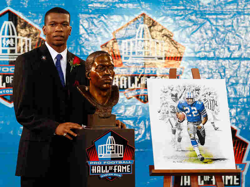 Bob Hayes Jr. poses with the bust of his late father.