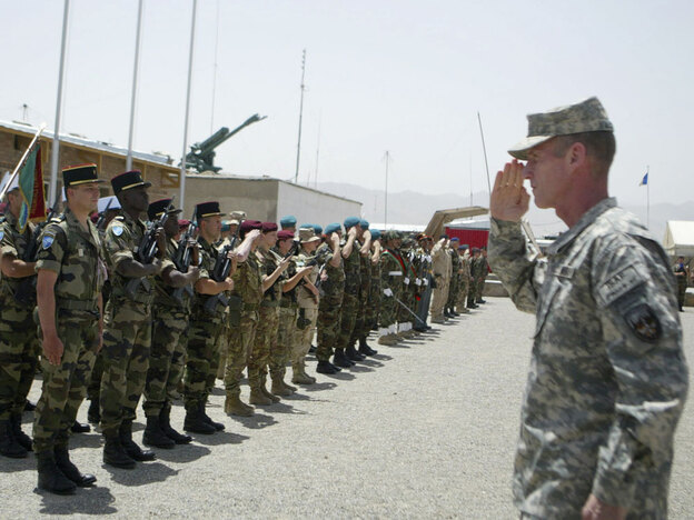 U.S. Gen. Stanley McChrystal, commander of the NATO-led International Security Assistance Force in Afghanistan, salutes ISAF soldiers during a changing of command ceremony in Kabul, Afghanistan, July 10, 2009.