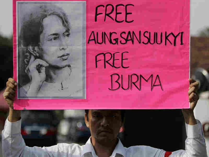 A protester holds a placard in support of Aung San Syi Kyi during in Kuala Lumpur, Malaysia.
