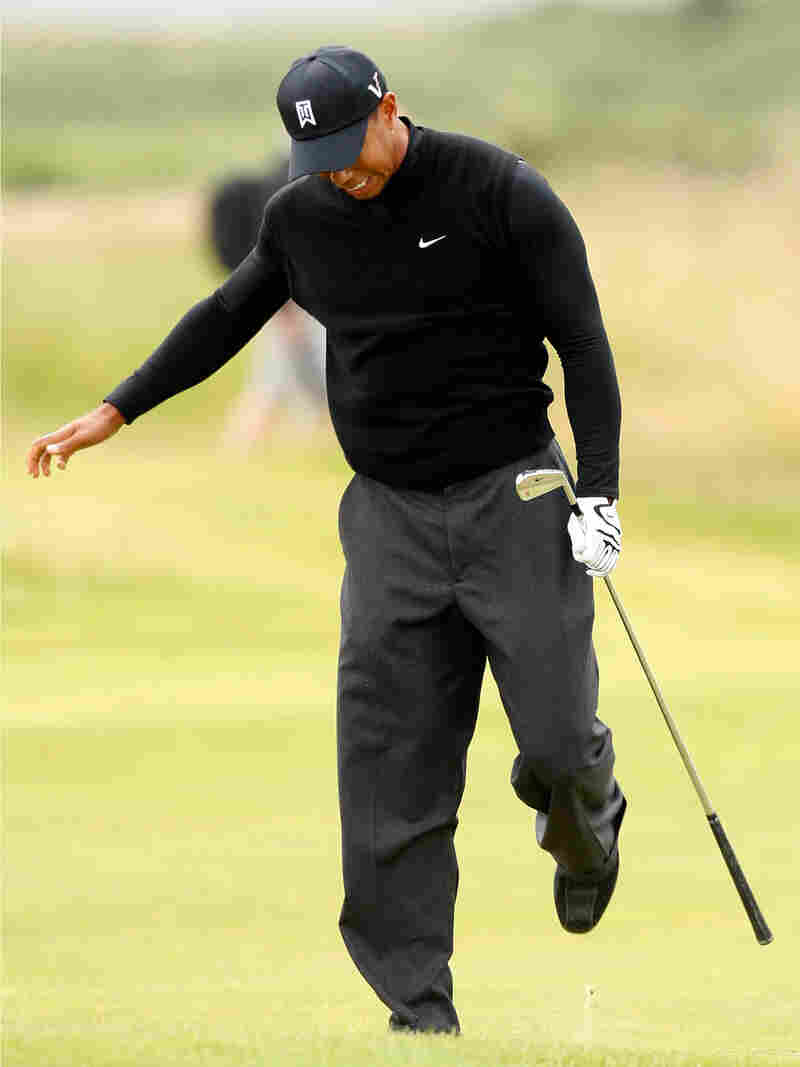 Tiger Woods reacts to a bad shot during July's British Open golf championship in Scotland.