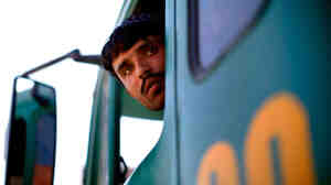 Wide: Truck drivers in Afghanistan are often threatened by Taliban insurgents.