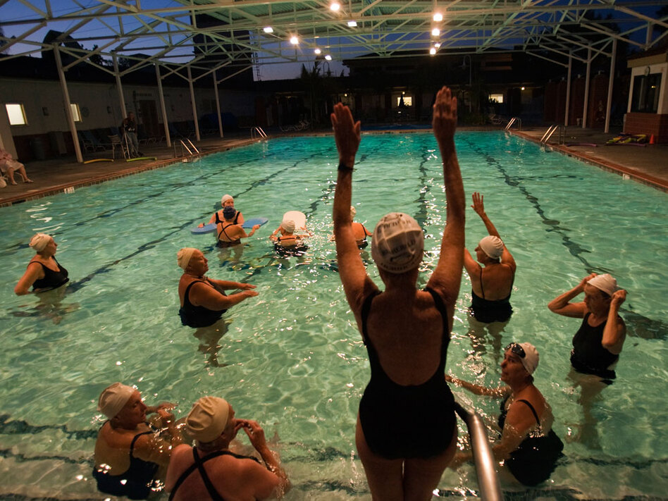 Despite having to rely on a cane and a walker to help her get around due to multiple sclerosis, Margo Bouer takes part in synchronized swimming at the Laguna Woods Village clubhouse pool.