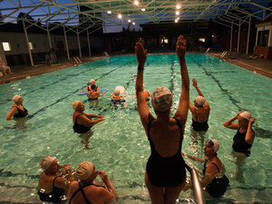 Margo Bouer takes part in synchronized swimming at the Laguna Woods Village clubhouse pool.
