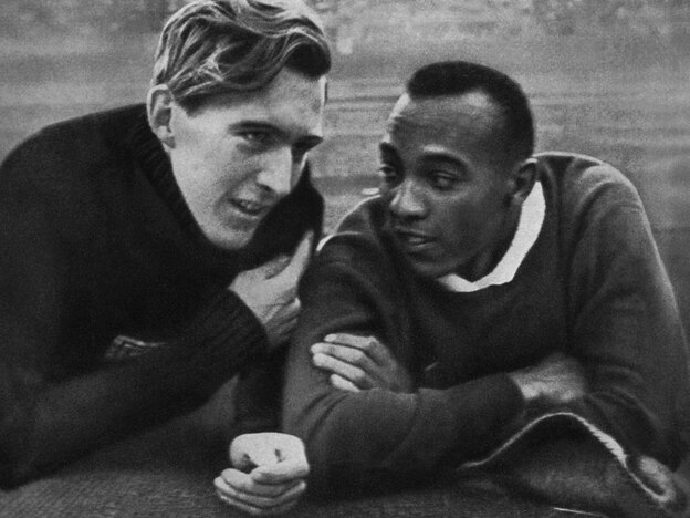 U.S. gold medalist Jesse Owens talks to German silver medalist Luz Long at the 1936 Olympic Games in Berlin.