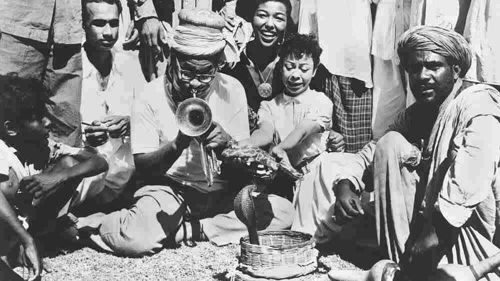Dizzy Gillespie plays for snakes. Karachi, Pakistan, 1956.(Courtesy of the Marshall Stearns Collecti