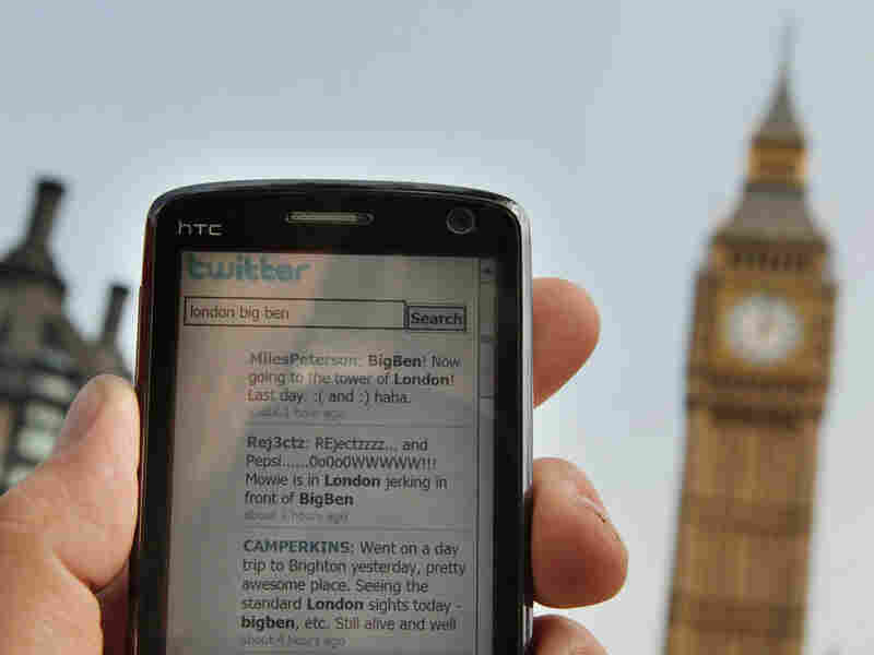 The Twitter Web site is displayed on a mobile phone near Parliament  in London.