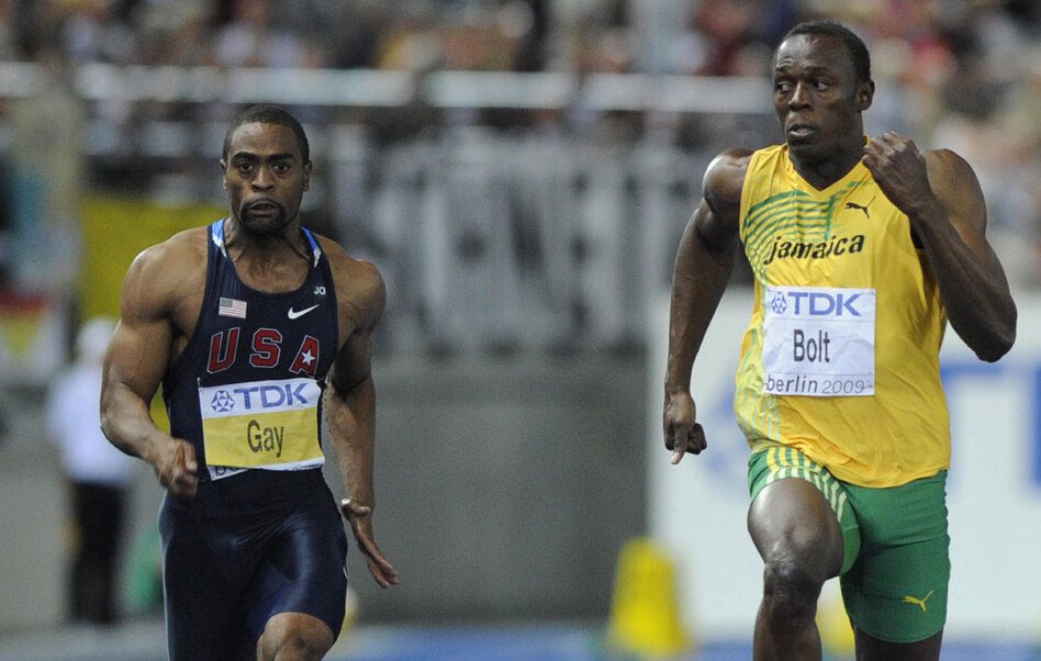 Jamaica's Usain Bolt (right) won the men's 100-meter final race in the world track and field championships Sunday in Berlin in 9.58 seconds, just ahead of the U.S.'s Tyson Gay.