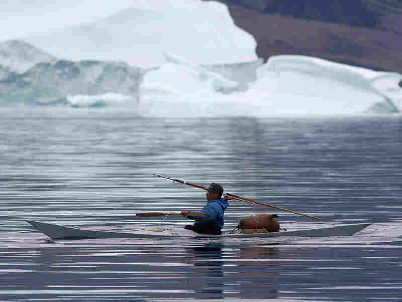 Hunter Mads Ole Kristiansen of Qaanaaq takes aim with his harpoon.