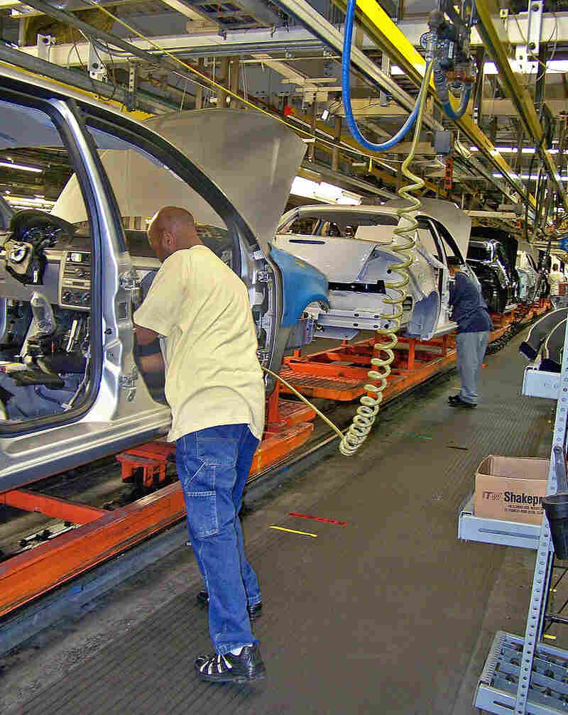 Auto worker pictured in August assembling a Chevy Cobalt at GM's Lordstown Plant in Ohio.