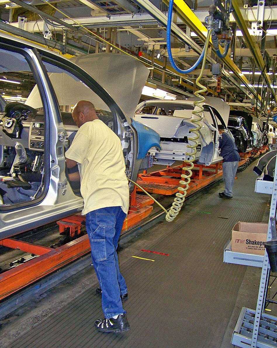 An autoworker assembles a Chevy Cobalt at General Motors' Lordstown Plant in northeastern Ohio. Because of increased demand for the Cobalt, Lordstown will add a second shift this fall. But the upcoming Chevy Cruze is the main focus of the plant now.
