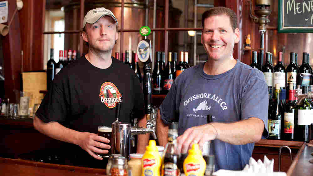 Wide: Brewmaster Neil Atkins (left) and owner Phil McAndrews of Offshore Ale, Co., in Oak Bluffs