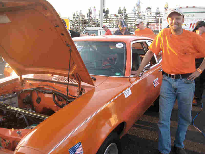 Mike Willmon stands next to his 1978 Ford Pinto at the racetrack.