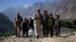 Men walk to the animal clinic to vote in northern Afghanistan