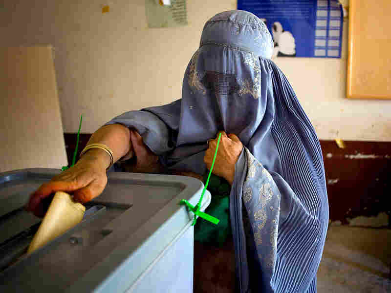 Anar Gula, mother of 11, casts her ballot