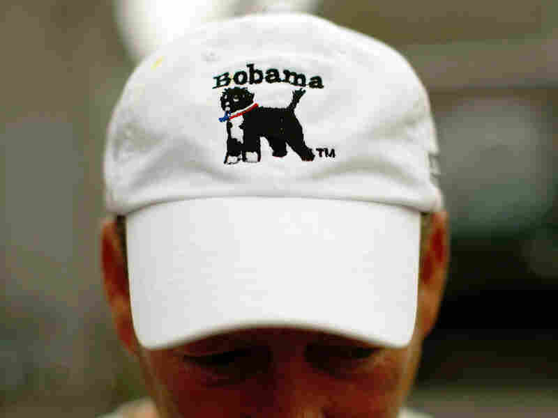 John Farrington shows off a hat he designed featuring President Obama's dog, Bo.