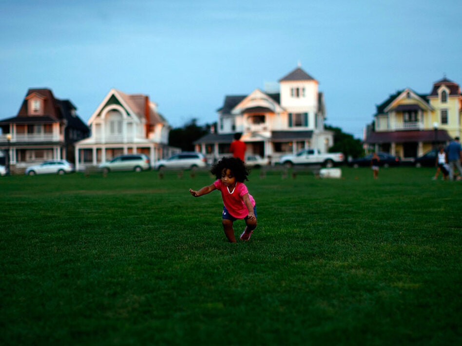A child plays in Ocean Park, with the famed Victorian-style homes in the background, in Oak Bluffs, Mass., on the island of Martha's Vineyard. President Obama and his family will visit the Vineyard next week.