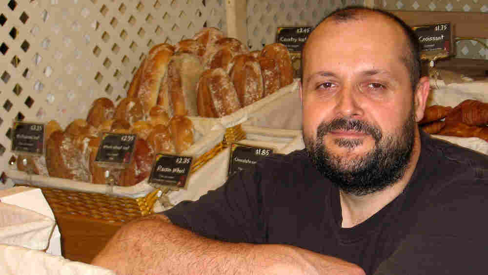 Baker Bertrand Houlier with the sweet treats and breads he makes