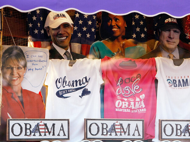 Items featuring President Obama and his wife, Michelle — along with former Alaska Gov. Sarah Palin and Sen. John McCain — are displayed in the window of the Soft As A Grape store in Edgartown, Mass.