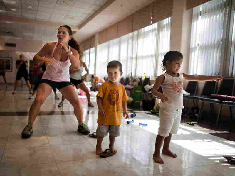 Rosina Aguiar of McLean, Va., brought her kids to the Mommy Bootie Camp workout.