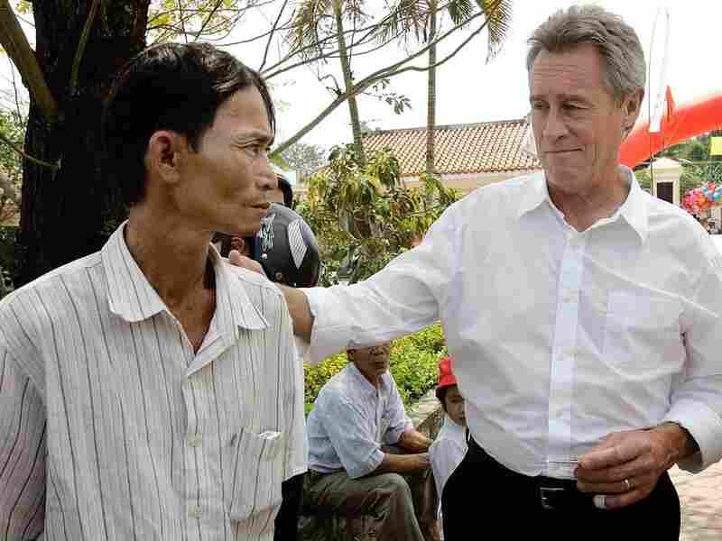 Lawrence Colburn greets My Lai Massacre survivor Do Ba in 2008. Chitose Suzuki/AP