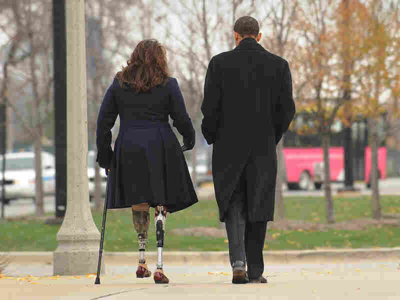 Then President-elect Barack Obama walks with veteran Tammy Duckworth  on Veterans Day, 2008.