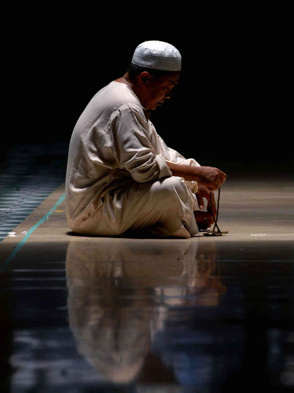 Vertical Muslim prays during Ramadan