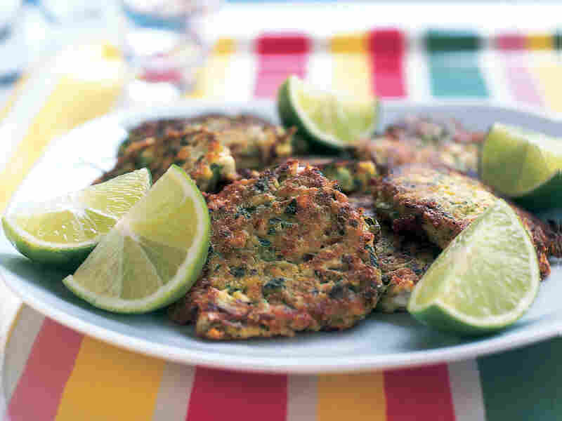 Fresh herbs and lime help keep these fritters light enough to enjoy as a summer's lunch.