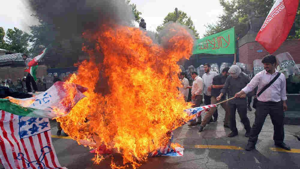 Wide: Iranian hard-line students burn U.S. and British flags, June 2009