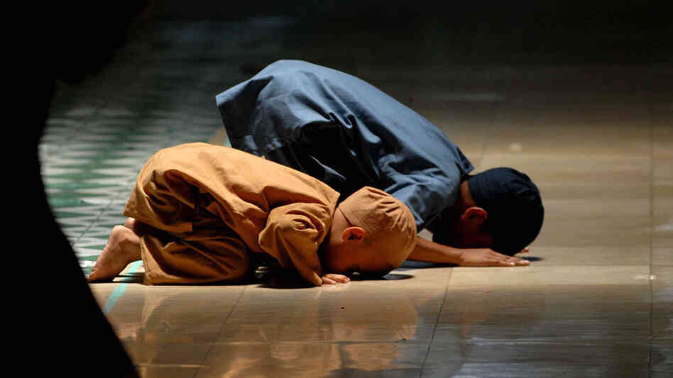 Muslim children pray at a mosque during the holy month of Ramadan.