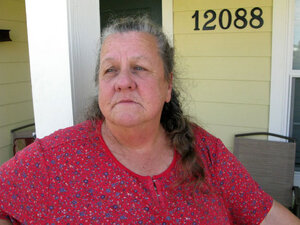 Belinda Wilkerson on the front porch of her FEMA cottage in Safe Harbor Estates, a new subdivision.