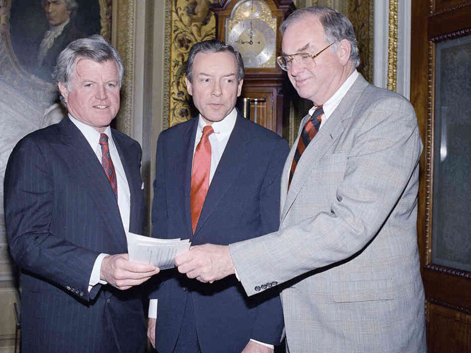 Sens. Edward Kennedy (left),  Orrin Hatch and Lowell Weicker on Capitol Hill in 1988.