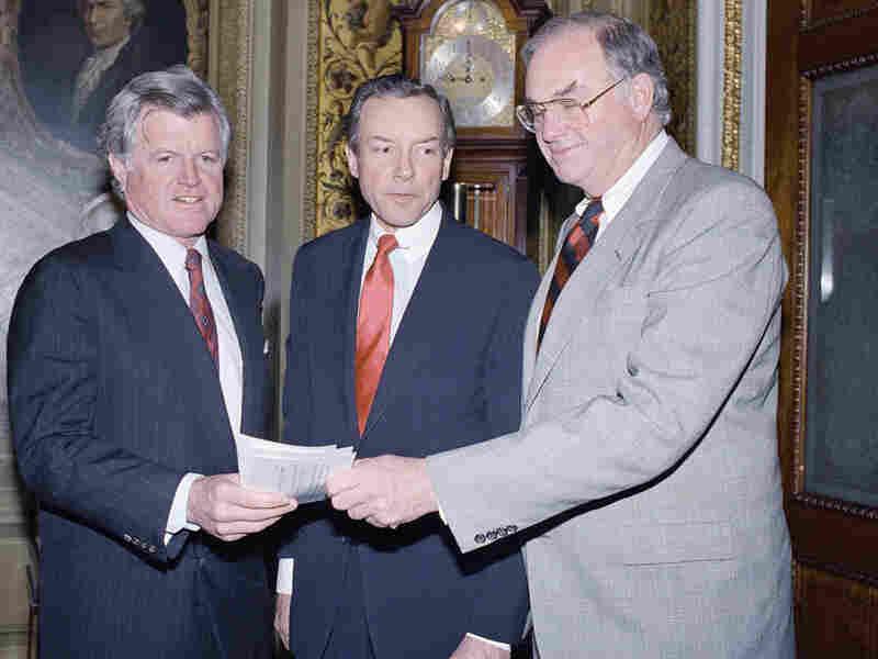Sens. Edward Kennedy (left),  Orrin Hatch and Lowell Weicker on Capitol Hill in 1988.