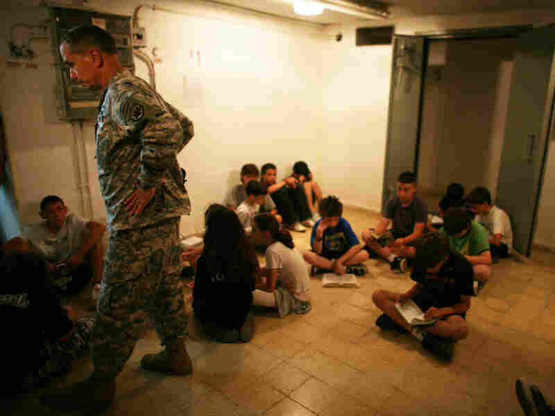 A U.S Army representative joins Israeli schoolchildren in a Tel Aviv bomb shelter, June 2, 2009