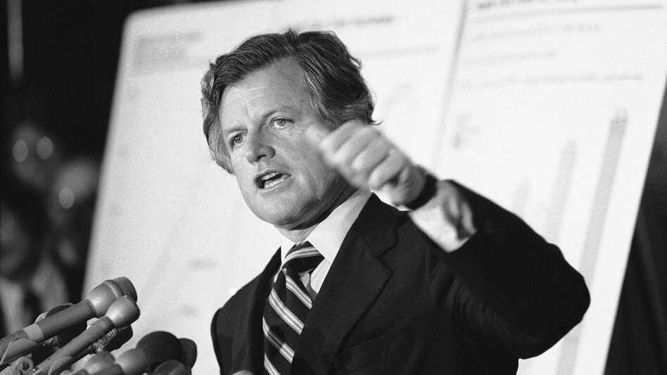 Sen. Edward Kennedy announced his proposal for a national health care plan at the Capitol on May 15, 1979. Behind him, large charts illustrate rising health costs in the U.S.